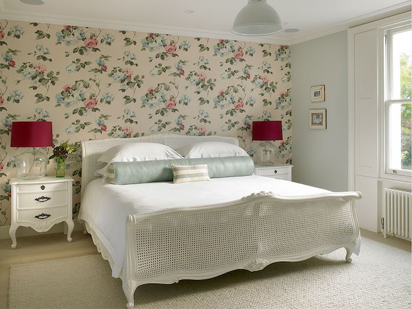 Margin Drive - bedroom painted in light blue with wallpapered feature wall