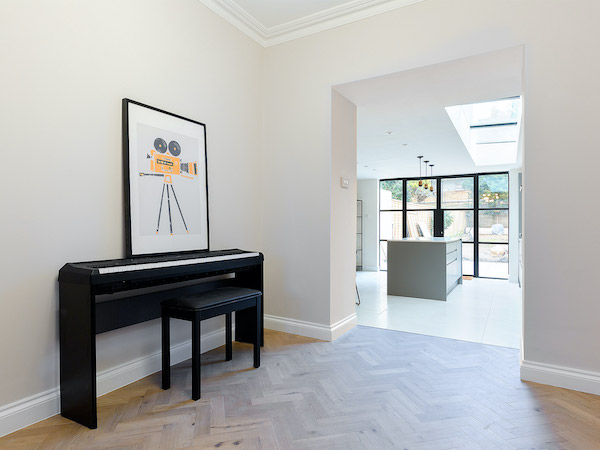 Pelham Road - lounge room painted in cream with white woodwork and ceilings