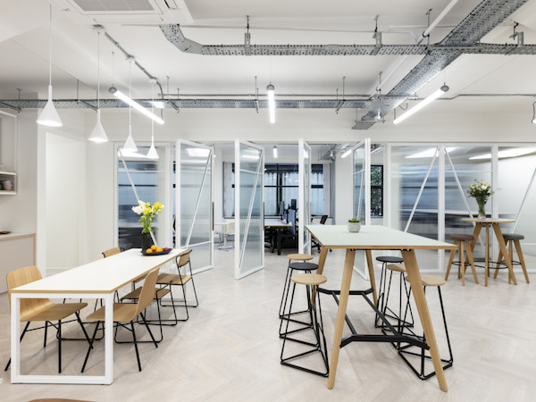 Workstories - open-plan office painted in white